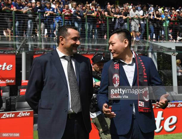 Milan new board member David Han Li and new AC Milan Sporting Director Massimo Mirabelli chat prior to the Serie A match between FC Internazionale...