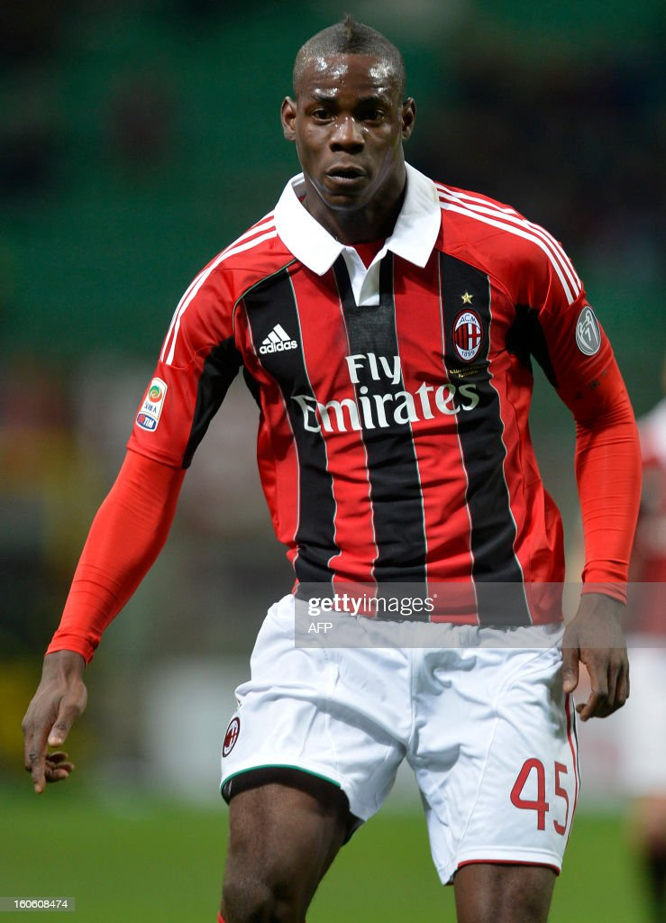 AC Milan new striker Mario Balotelli runs for the ball during the AC Milan vs Udinese Italian serie A football match on February 3, 2012 at San Siro stadium in Milan.