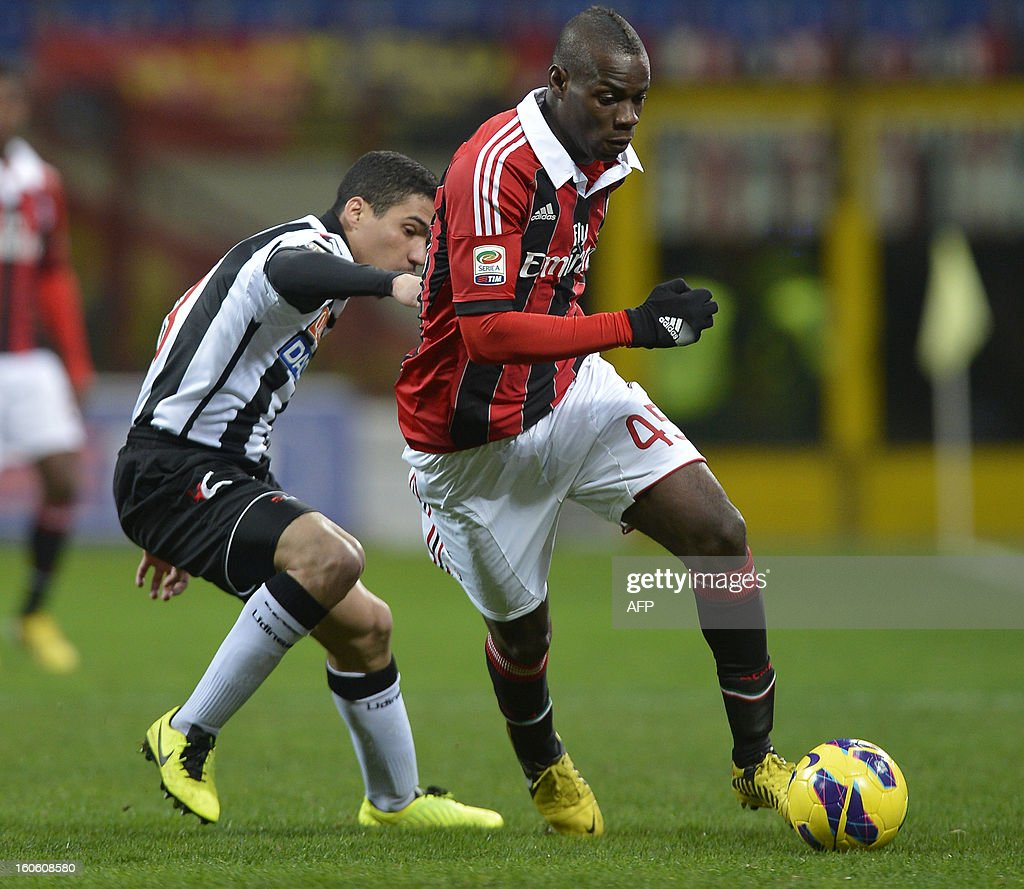 AC Milan new striker Mario Balotelli (R) runs with the ball during the AC Milan vs Udinese Italian serie A football match on February 3, 2012 at San Siro stadium in Milan.