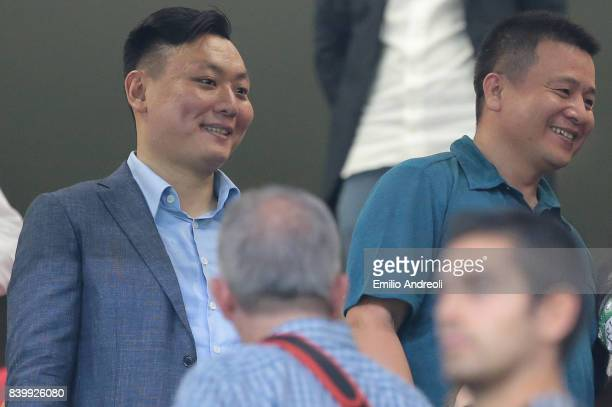 Milan Owner and President Yonghong Li speaks with AC Milan board member David Han Li prior to the Serie A match between AC Milan and Cagliari Calcio...