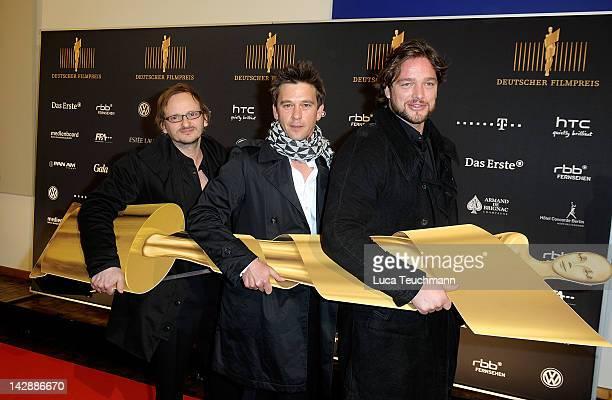 Milan Pesche Peter Schneider and Ronald Zehrfeld attend nominees reception for the 'Deutscher Filmpreis' at the PanAm Lounge on April 14 2012 in...