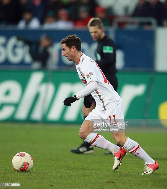 Milan Petrzela of Augsburg in action during the Bundesliga match between FC Augsburg and FC Bayern Muenchen at SGL Arena on December 8 2012 in...