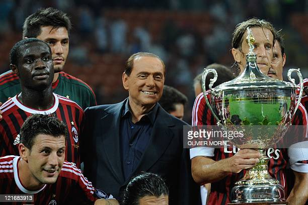 AC Milan players and Italian President of Council Silvio Berlusconi pose after winning the Trophee Luigi Berlusconi match AC Milan against Juventus...