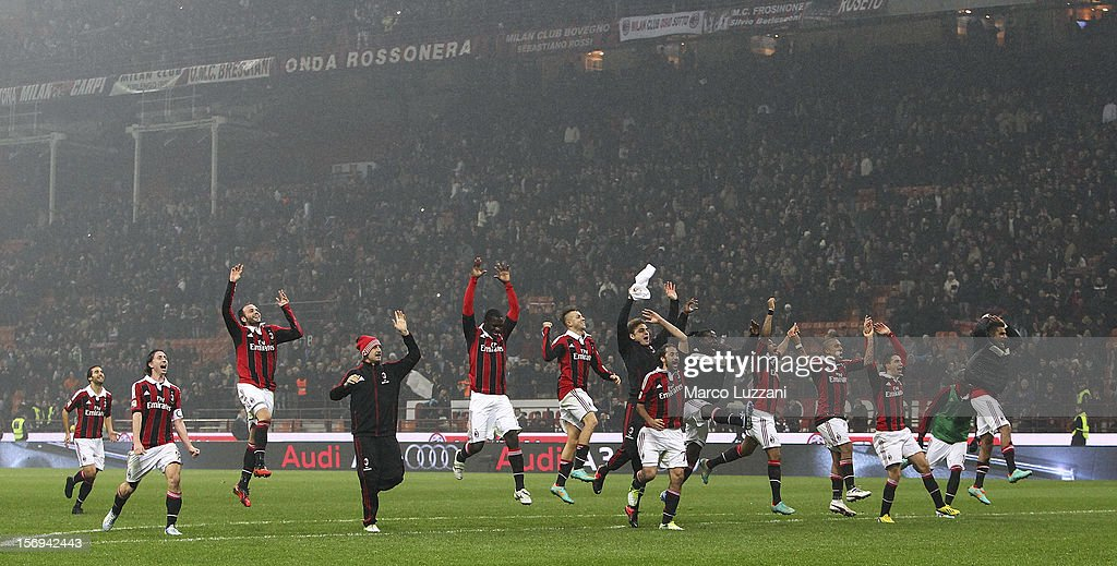 AC Milan players celebrate a victory at the end of the Serie A match between AC Milan and Juventus FC at San Siro Stadium on November 25, 2012 in Milan, Italy.