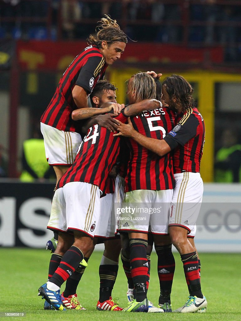 AC Milan players celebrate after the opening goal during the UEFA Champions League group H match between AC Milan and Celtic at Stadio Giuseppe Meazza on September 18, 2013 in Milan, Italy.