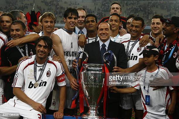 AC Milan players celebrate winning the 20062007 UEFA Champions League final between AC Milan and Liverpool FC with their president Silvio Berlusconi