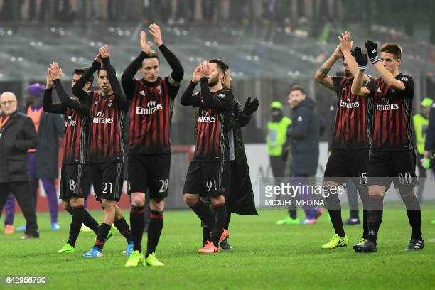 AC Milan players salute the public after winning the Italian Serie A football match between AC Milan and Fiorentina at the San Siro Stadium in Milan...