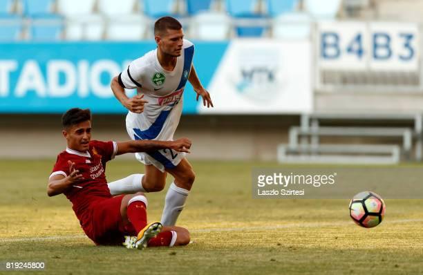 Milan Sagi of MTK Budapest II fouls Yan Dhanda of FC Liverpool U23 during the Preseason Friendly match between MTK Budapest II and FC Liverpool U23...