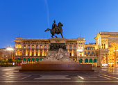 Equestrian monument to King Victor Emmanuel II in the night illumination at the Duomo Square. Milan. Italy.