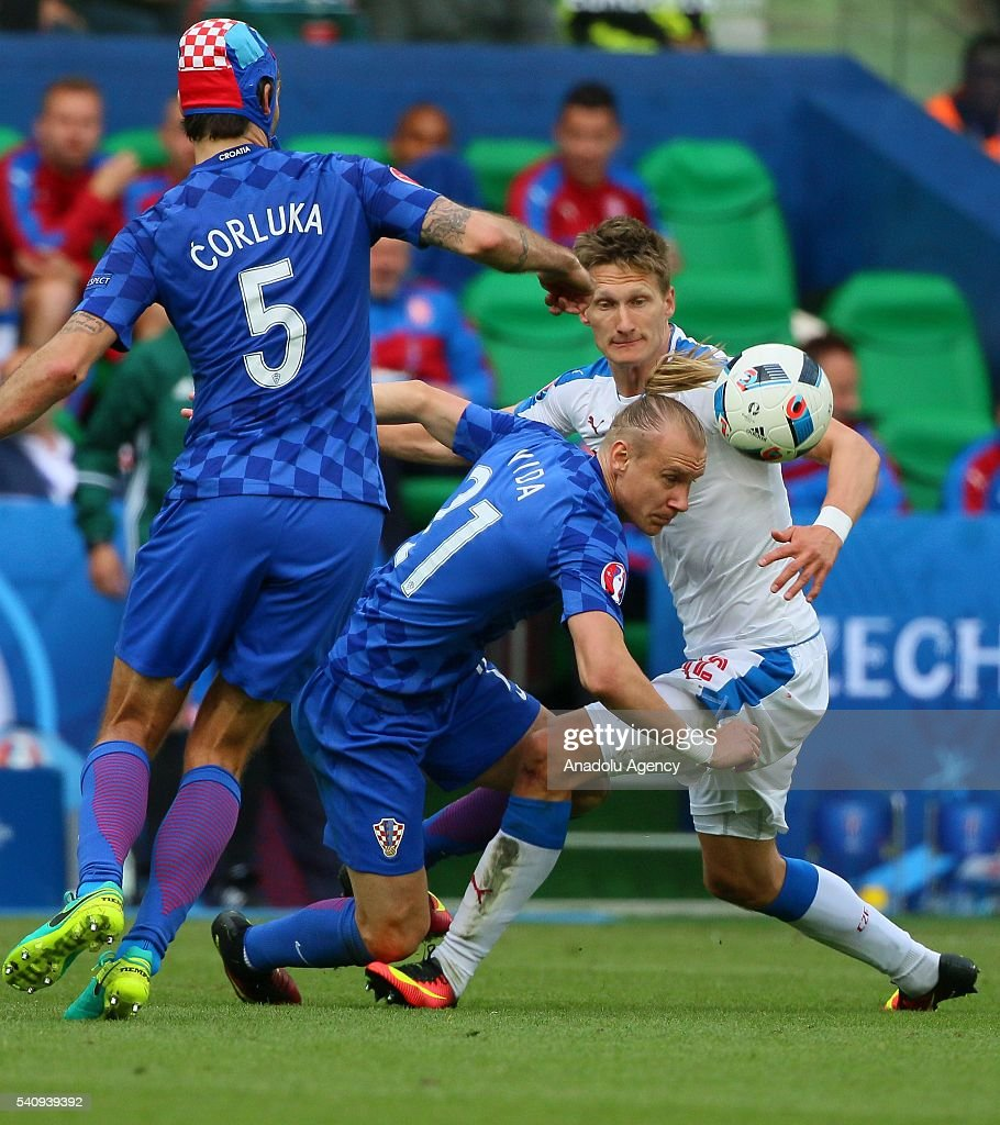 Milan Skoda of Czech Republic in action against Corluka and Vida of Croatia during the UEFA Euro 2016 Group D match between Czech Republic and...