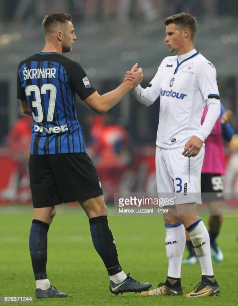 Milan Skrinia of FC Internazionale shakes hands with Hans Hateboer during the Serie A match between FC Internazionale and Atalanta BC at Stadio...