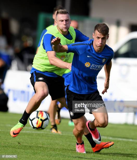 Milan Skriniar and Andrea Pinamonti of FC Internazionale compete for the ball during the FC Internazionale training session on July 12 2017 in...