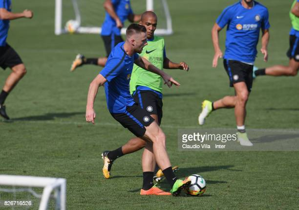 Milan Skriniar and Joao Mario of FC Internazionale in action during a training session at Suning Training Center at Appiano Gentile on August 3 2017...