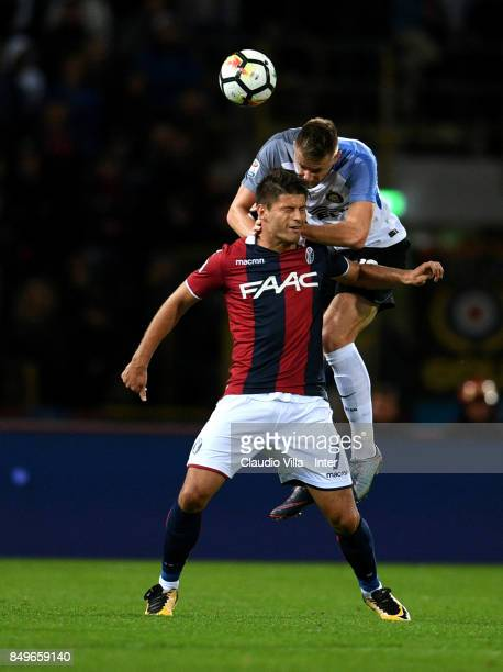 Milan Skriniar of FC Internazionale and Bruno Petkovic of FC Internazionale compete for the ball during the Serie A match between Bologna FC and FC...