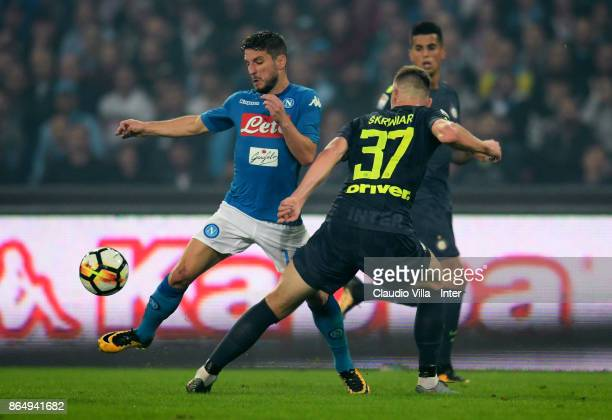 Milan Skriniar of FC Internazionale and Dries Mertens of SSC Napoli compete for the ball during the Serie A match between SSC Napoli and FC...