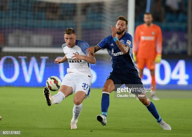 Milan Skriniar of FC Internazionale and Guido Burgstaller of FC Schalke 04 compete for the ball during the preseason friendly match between FC...