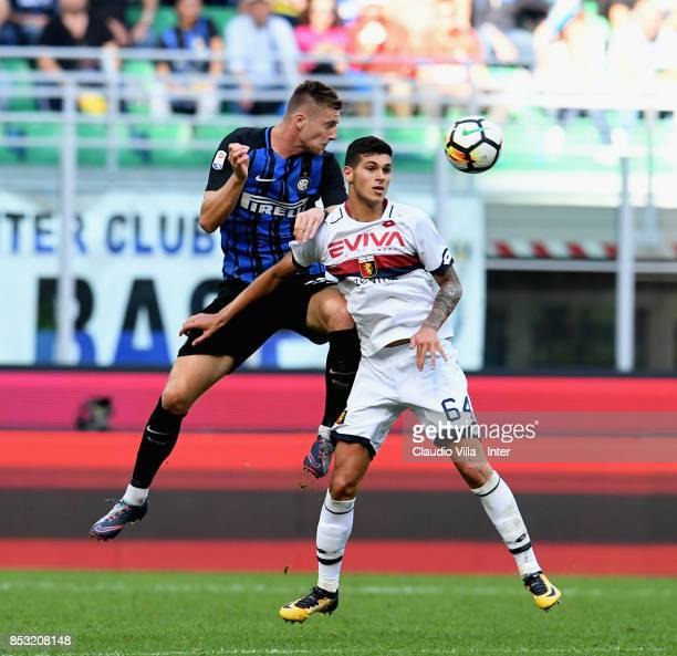 Milan Skriniar of FC Internazionale and Pietro Pellegri of Genoa CFC compete for the ball during the Serie A match between FC Internazionale and...