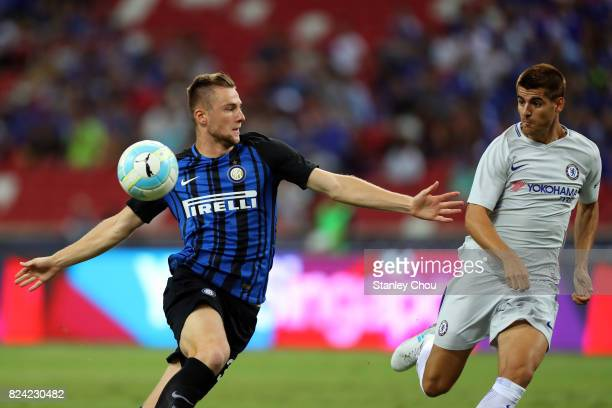 Milan Skriniar of FC Internazionale challenges Alvaro Morata of Chelsea FC during the International Champions Cup match between FC Internazionale and...