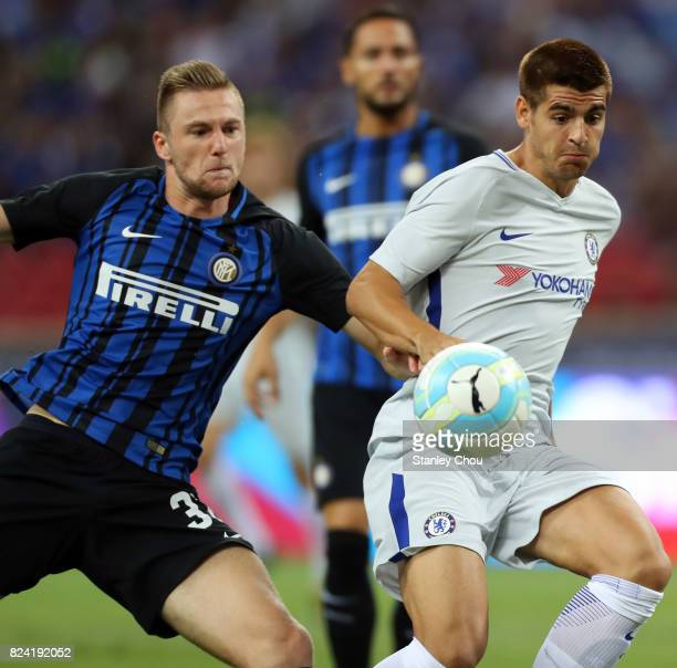 Milan Skriniar of FC Internazionale challenges Cesar Azpilicueta of Chelsea FC during the International Champions Cup match between FC Internazionale...
