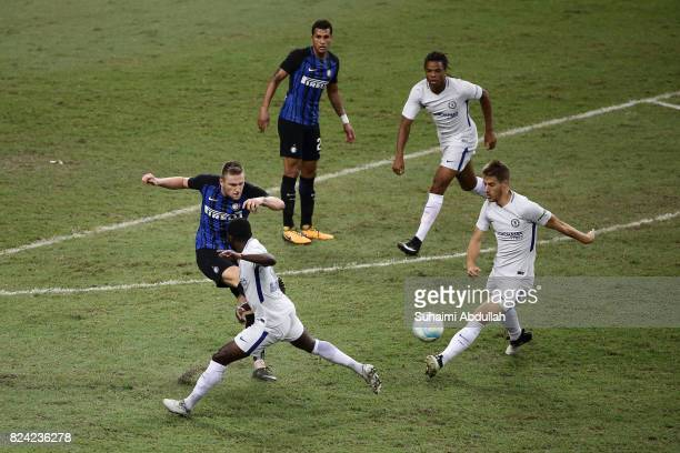 Milan Skriniar of FC Internazionale clears the ball during the International Champions Cup match between FC Internazionale and Chelsea FC at National...