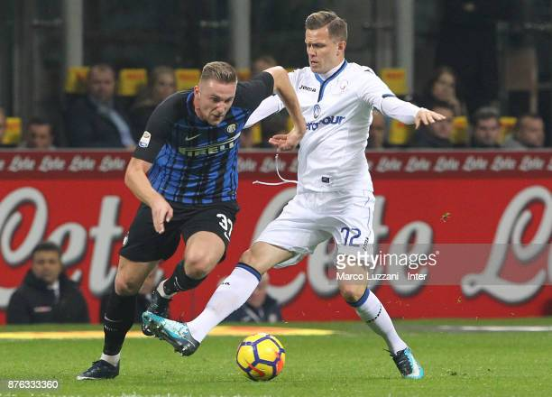 Milan Skriniar of FC Internazionale competes for the ball with Josip Ilicic of Atalanta BC during the Serie A match between FC Internazionale and...
