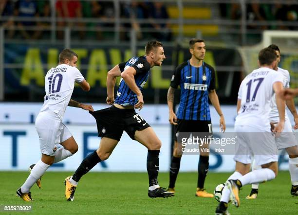 Milan Skriniar of FC Internazionale competes for the ball with Valentin Eysseric of ACF Fiorentina during the Serie A match between FC Internazionale...