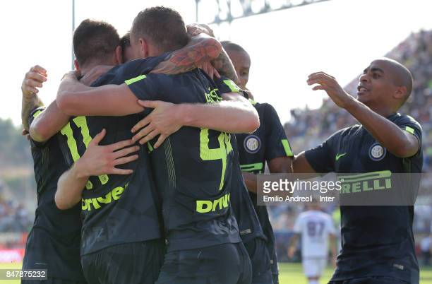 Milan Skriniar of FC Internazionale Milano celebrates with his teammates after scoring the opening goal during the Serie A match between FC Crotone...