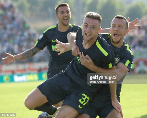 Milan Skriniar of FC Internazionale Milano celebrates with his teammate Ivan Perisic after scoring the opening goal during the Serie A match between...