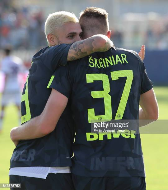 Milan Skriniar of FC Internazionale Milano celebrates with his teammate Mauro Emanuel Icardi after scoring the opening goal during the Serie A match...