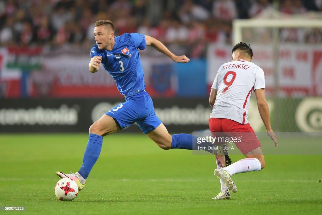Milan Skriniar of Slovakia goes past Mariusz Stepinski of Poland during the UEFA European Under-21 Championship match between Poland and Slovakia at Lublin Stadium on June 16, 2017 in Lublin, Poland.