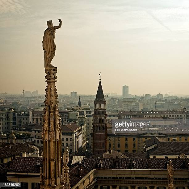 Milan skyline and statue