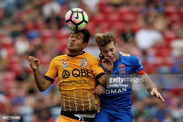 Milan Smiljanic of the Glory contests the header against Andrew Hoole of the Jets during the round 15 ALeague match between the Newcastle Jets and...