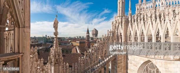 Milan spires statues landmarks Duomo terrace city rooftop panorama Italy