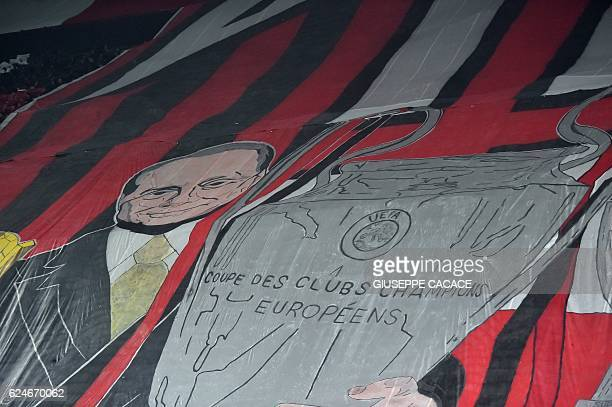 AC Milan supporters deploy a giant flag showing Silvio Berlusconi holding a trophy at the end of the Italian Serie A football match AC Milan Vs Inter...