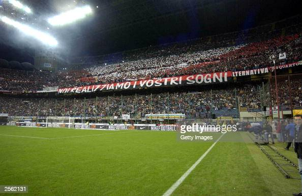 Milan supporters enjoy the atmosphere during the Serie A match between Internazionale and AC Milan at the San Siro October 5 2003 in Milan Italy