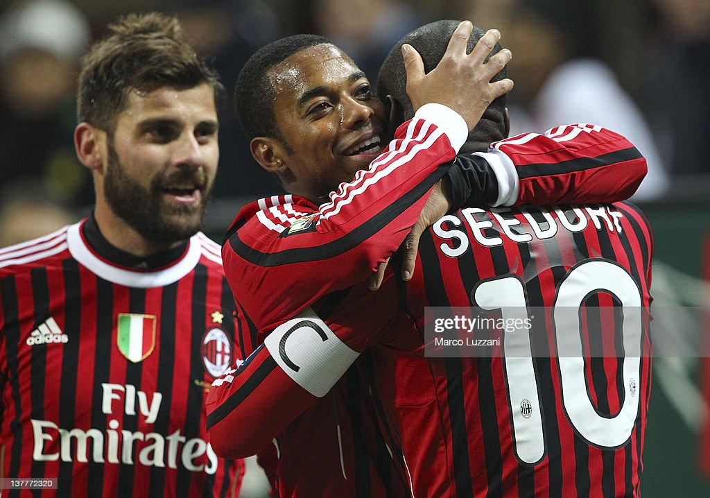 AC Milan team-mates <a gi-track='captionPersonalityLinkClicked' href=/galleries/search?phrase=Clarence+Seedorf&family=editorial&specificpeople=208215 ng-click='$event.stopPropagation()'>Clarence Seedorf</a> (R) and <a gi-track='captionPersonalityLinkClicked' href=/galleries/search?phrase=Robinho&family=editorial&specificpeople=210767 ng-click='$event.stopPropagation()'>Robinho</a> (C) celebrate a goal during the Tim Cup match between AC Milan and SS Lazio at Giuseppe Meazza Stadium on January 26, 2012 in Milan, Italy.