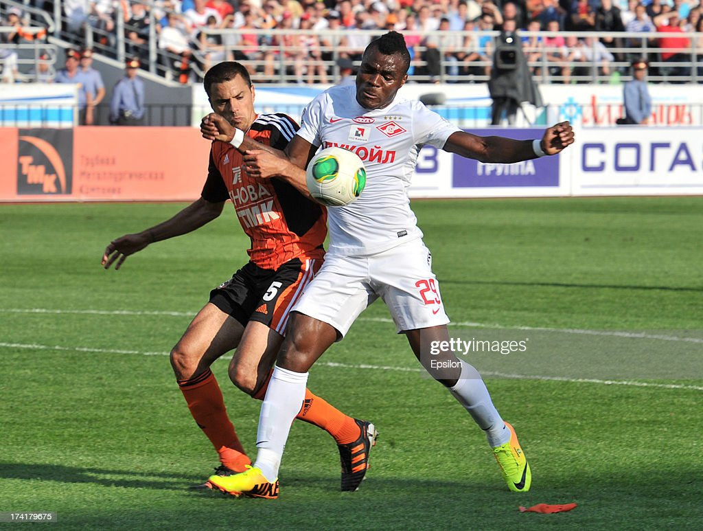 Milan Vjestica (L) of FC Ural Sverdlovsk Oblast is challenged by Emmanuel Emenike of FC Spartak Moscow during the Russian Premier League match betweenn FC Ural Sverdlovsk Oblast and FC Spartak Moscow at the Tcentralny Stadium on July 21, 2013 in Ekaterinburg, Russia.