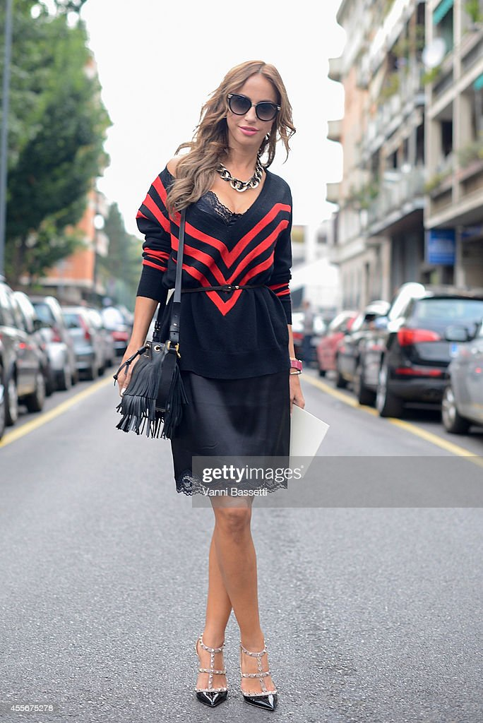 Milana Koroleva poses wearing a Dolce and Gabbana dress Prada jumper Ralph Laurent bag and Valentino shoes on September 18 2014 in Milan Italy