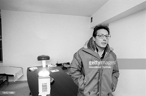 Milanese singersongwriter Enzo Jannacci standing his surgery where he works as a doctor wearing a parka 1978