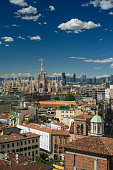 Milano, 2016 panoramic skyline with clear sky and italian Alps on background