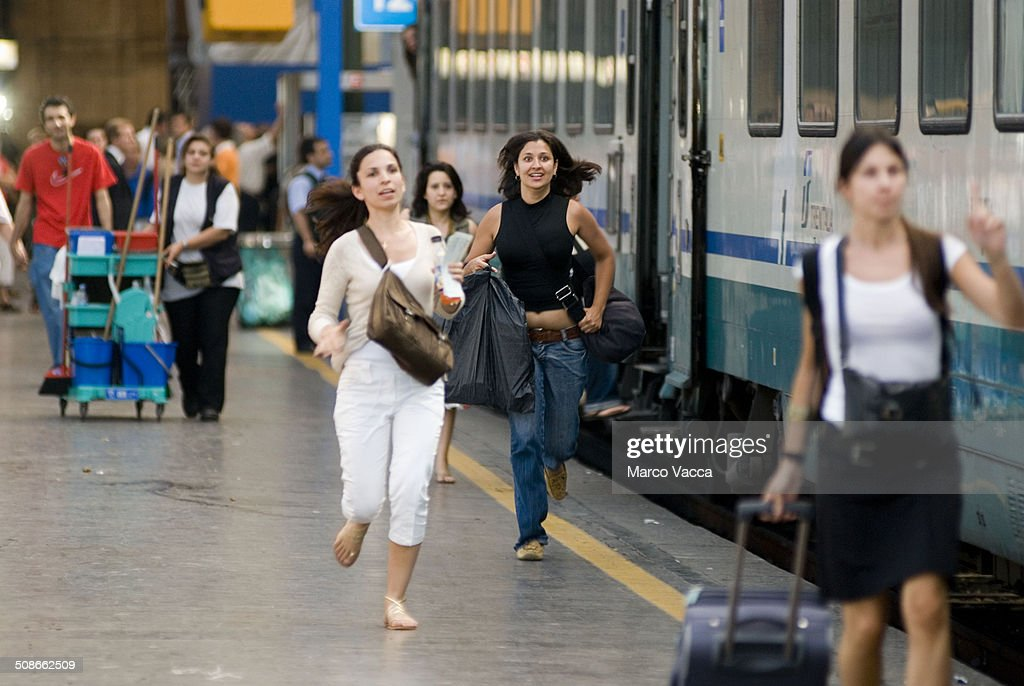 girls rushing along the rail to catch their train