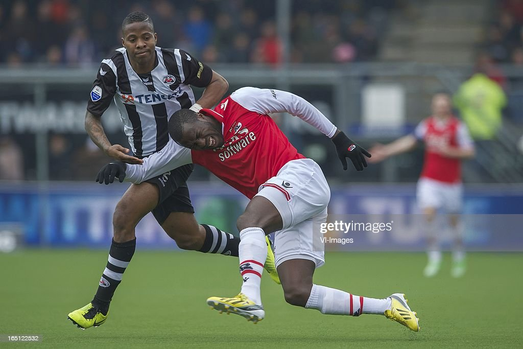 Milano Koenders of Heracles Almelo, Jozy Altidore of AZ during the Dutch Eredivisie match between Heracles Almelo and AZ Alkmaar at the Polman Stadium on march 31, 2013 in Almelo, The Netherlands