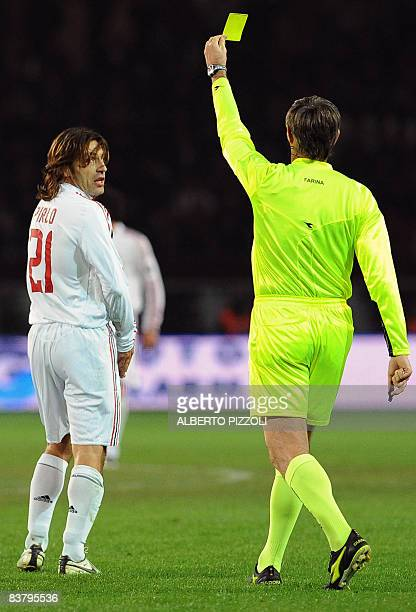 AC Milan's AC Milan's midfielder Andrea Pirlo is shown a yellow card by referee Stefano Farina during his team's Italian serie A football match...