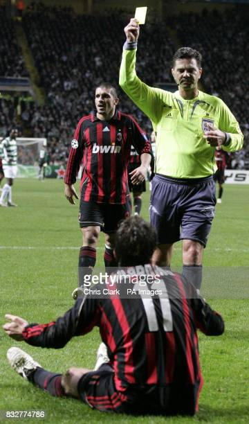 AC Milan's Alberto Gilardino dives into the Celtic penalty area and was booked by the referee Terje Hauge during the Champions League first knockout...