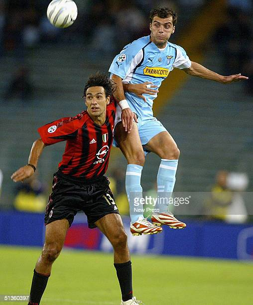 Milan's Alessandro Nesta and Lazio's Antonio Filippini compete for the ball during the Serie A match between SS Lazio and AC Milan at the Stadio...