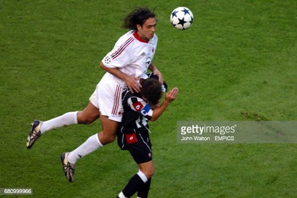 AC Milan's Alessandro Nesta wins an aerial dual with Juventus' Alessandro Del Piero