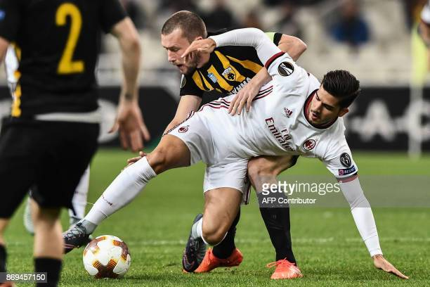 AC Milan's Andre Silva vies for the ball with AEK's Jakob Johansson during the UEFA Europa League Group D football match between AEK Athens and AC...