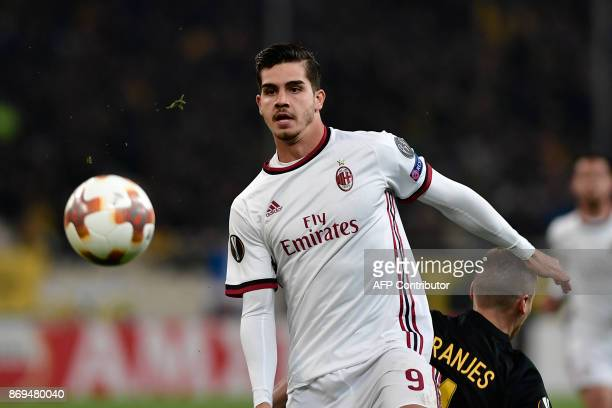 AC Milan's Andre Silva vies for the ball with AEK's Ognjen Vranjes during the UEFA Europa League Group D football match between AEK Athens and AC...