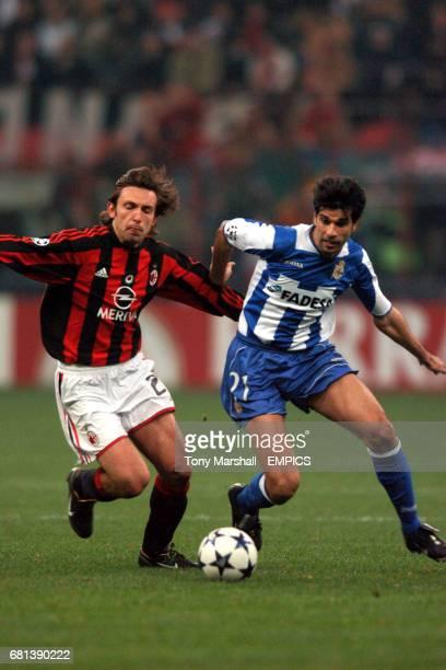 AC Milan's Andrea Pirlo and Deportivo La Coruna's Juan Valeron battle for the ball