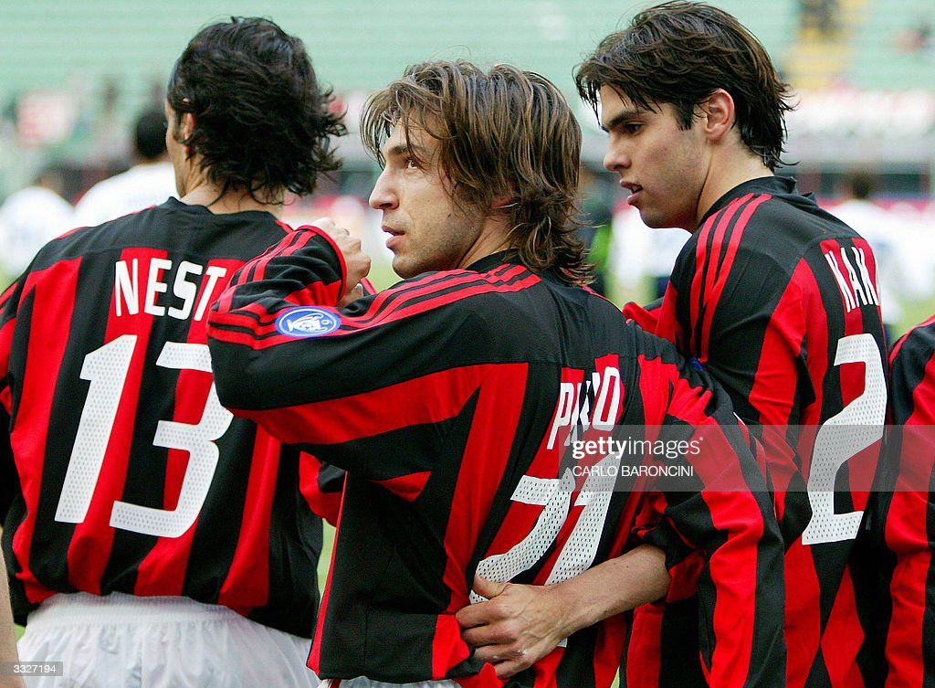 AC Milan's Andrea Pirlo (C) celebrates with his teammates Kaka (R) and Alessandro Nesta after scoring against Empoli during their Italian Serie A football match at Empoli's stadium 10 April 2004. AC Milan won the match 1-0. AFP PHOTO/Carlo BARONCINI